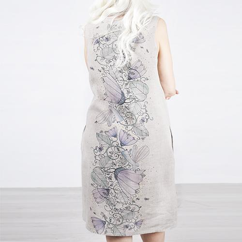 Natural linen dress with ornament on the back